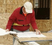 Man Looking at Papers, Design Firm in Ponte Vedra, FL